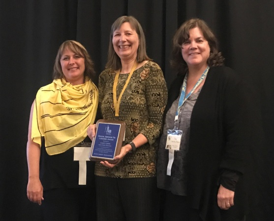Cindy Lunte, IdahoPTV's education specialist, is awarded the Idaho Library Association's 2017 Special Services to Libraries award by Staci Shaw (left) and Tamra Hawley-House (right) from the Idaho Commission for Libraries.