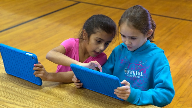 "Two students from Pioneer Primary School in Weiser learn to create animated stories using the PBS KIDS ScratchJr app. IdahoPTV Teacher Ambassador Kari Wardle led ""Hour of Code"" workshops for Weiser second- and third-graders on Dec. 5"